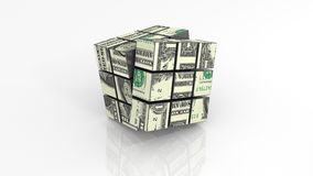 Dollar banknotes on rubiks cube unfinished Royalty Free Stock Photography