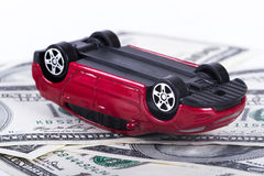 Dollar Banknotes and Toy Car Accident Stock Photo