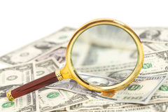 Dollar banknotes under magnifying glass Royalty Free Stock Photography
