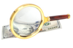 Dollar banknotes under magnifying glass Royalty Free Stock Photos