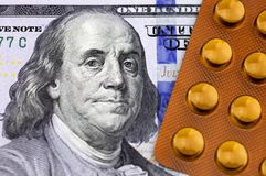 Dollars and medicines. Dollar banknotes and western medicine Stock Image