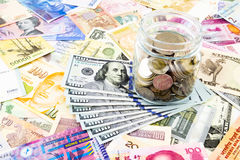 Dollar banknotes and world currency. Dollar banknotes world currency and coins, money concept for investment and banking business Royalty Free Stock Photos