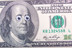 Dollar with big eyes Stock Photography