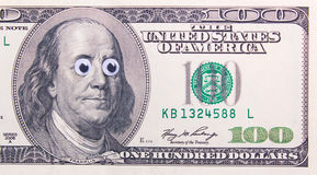 Dollar with big eyes Royalty Free Stock Image