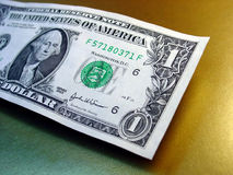 Dollar Bill. On gold background royalty free stock photography