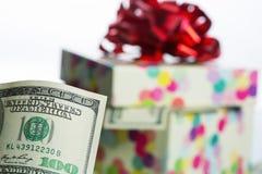 $100 dollar bill. Against gift box Stock Image