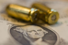 Dollar bill and ammo Royalty Free Stock Images