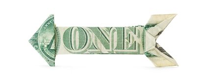 Dollar Bill Arrow. A dollar bill folded into an arrow shape Royalty Free Stock Photos