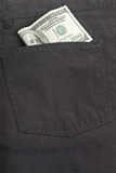 Dollar bill in back pocket of jeans Royalty Free Stock Image