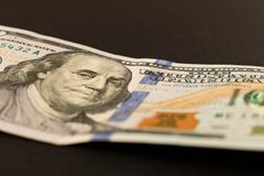 100 dollar bill. on black background. Selective focus.  royalty free stock photography