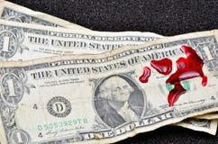 Dollar bill and blood. Close up photo Stock Photos