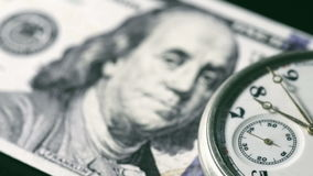100 dollar bill and chainwatch. Clock is ticking stock footage