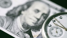 100 dollar bill and chainwatch. stock video footage