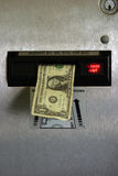 Dollar bill in a change machine. With please wait sign royalty free stock image