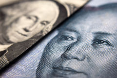 Dollar bill and a Chinese yuan Royalty Free Stock Image