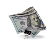 100 dollar bill with a clip. On a white background royalty free stock photography