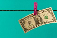 1 dollar bill on the clothesline. The concept of money laundering stock image