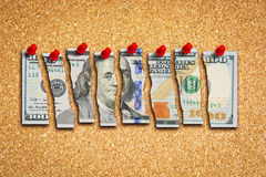 Dollar bill cut in many pieces suggesting US economy problems concept Royalty Free Stock Image