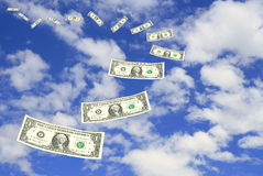 Dollar bill fly in sky Royalty Free Stock Photos