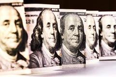100 dollar bill, the gaze of Benjamin Franklin, vertical location close-up. royalty free stock image