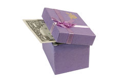 Dollar bill in a gift box. Dollar bill in a lilac gift box (isolated on white Royalty Free Stock Photography