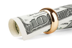 Dollar bill in a gold ring Stock Photos