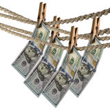 Dollar bill is hanging on a rope with wooden clothespin Stock Photos