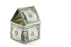 Dollar bill house. A house made of one dollar bills Stock Image