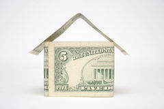 Dollar bill house. 5 dollar bills folded in the shape of a house or building Stock Images