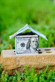 dollar bill house on a brick Stock Photo
