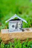 dollar bill house on a brick Stock Photo