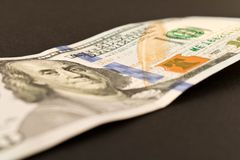 100 dollar bill. Isolated on black background. Selective focus.  royalty free stock photography