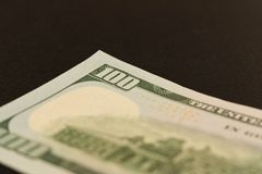 100 dollar bill. Isolated on black background. Selective focus.  royalty free stock images