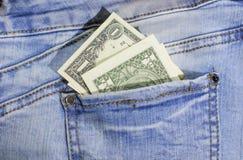 Dollar bill in jeans pocket. Paper money bill royalty free stock photos