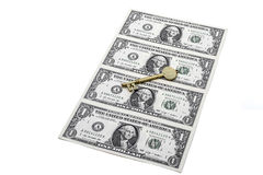 Dollar bill and key. Brass key on top of dollar bill on white background Stock Images