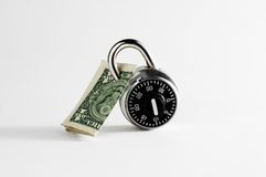 Dollar Bill Locked Up. With combination lock royalty free stock image