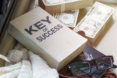 Dollar bill ,passport, business document and key of success book stock photography