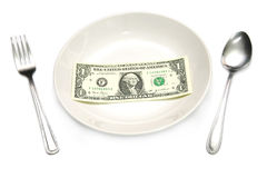 A dollar bill in plate Stock Photo