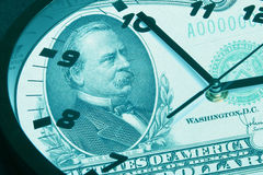 Dollar bill reflected in clock Stock Images