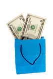Dollar bill on a Shopping bag. With clipping path royalty free stock image