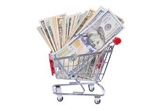 Dollar bill in the shopping trolley Royalty Free Stock Photos