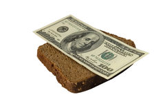 Dollar bill on a slice of bread Stock Photos