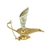 Dollar bill sticking out of magic lamp of Aladdin Stock Photo