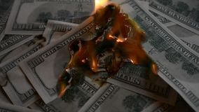 Dollar bill USA money burning in flames. Money depreciation concept stock video footage