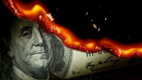 Dollar bill USA money burning in flames. Economic crisis or inflation concept. UHD stock video footage