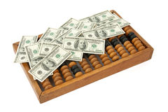 Dollar bills with abacus Royalty Free Stock Photo