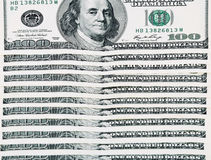 100 dollar bills arranged horizontally Stock Photo