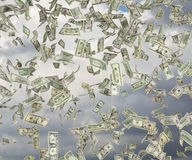 Dollar bills. Dollar banknote falling on a sky background Royalty Free Stock Photo