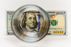 100 dollar bills that are behind glass.  Stock Photo