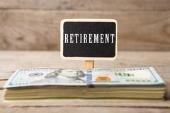 Dollar bills, blackboard with text Retirement stock photography